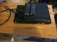 Two DVD players with remote controls all in good working order.