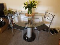 Two seater glass table with onix stone base