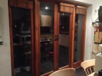 French doors with two side lights. Natural hardwood.