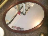 Oval mahogany bevelled mirror