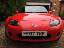 Red Mazda MX5 soft top. Superb condition. Perfect for summer