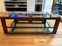 Stylish TV Stand imported from the US, made of cherry hardwood, metal and tempered glass.