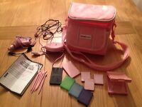 Pink Nintendo DS deluxe pack with carry bag and spare cases