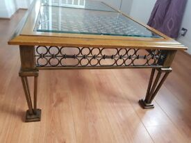 Beautiful large brass framed wood and glass coffee table.