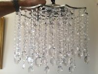 Two glass chandelier style ceiling lights
