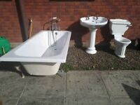 Bath and sink with chrome and gold taps and toilet. All very good condition. Bath is 1.7 metres