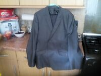 one new suit one worn once designer suits