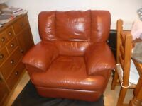 Tan leather recliner, some small scuff marks