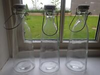 3 Tall Glass pots with white 'grolsch' style lids