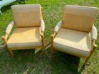A pair of beech chairs.
