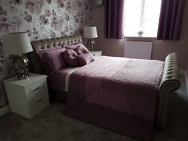 New double bed, two bedside cabinets, two bedside lamps, all bedding