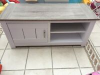 White & wood TV stand with storage space