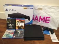 PS4 Slim 500GB (only 4 months old) and 4 games