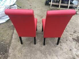 X2 red dining chairs. Great condition. Brand new
