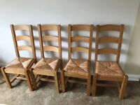 4 wooden and wicker chairs