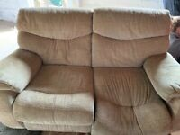 Free two-seater gold sofa. Electric still working.
