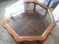 OCTAGONAL GLASS TOPPED COFFEE TABLE.