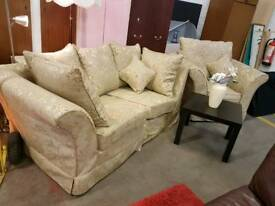 Patterned fabric two seater and chair suite