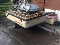 Camping trailer with rack