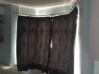 Black curtains and bay curtain rail
