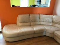 Cream leather sofa with reclining End.