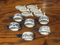 12 ceramic pieces:6 napkin rings and 6 fish shaped knife rests in blue and white