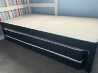 Divan single bed with trundle bed.