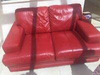 2 red leather sofas