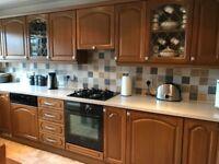 Medium Oak wall & base fitted kitchen units