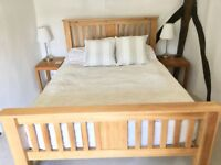 Hardly used Solid oak double bed with mattress