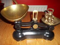 Kitchen scales with weights. Black scales with brass imperial weights included.