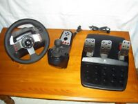Logitech G27 steering wheel & 6 speed shifter & pedals.