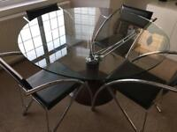 Glass & chrome dining table and chairs