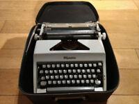 Vintage Typewriter, Olympia Werke, Wilhelmshaven, with leather case