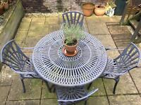 Wrought iron style garden table and four chairs
