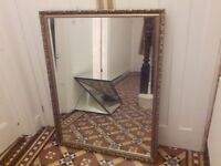 Large bevelled edge mirror in gold frame