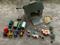 Farm yard toy set includes barn, tractors, animals, fences, tools, winch, hay bales, trees etc.
