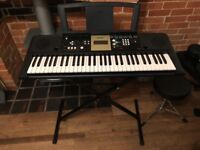 Yamaha YPT-220 keyboard with stand.
