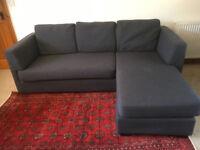 L shaped sofa in dark grey material