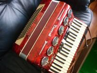 beautiful parrot full size120 bass accordian/case,various tones,lovely red pearscent casing,v/nice..