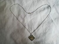 Steel and gold necklace with zodiac pendant