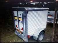 Trailer,small and compact was used as a luggage trailer for a transport company !