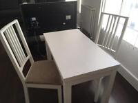 IKEA dining table with two chairs