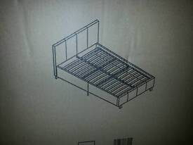 New white double bed in a box