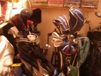 Two Bags of golf Clubs and Trolleys