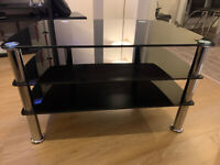 BLACK TV STAND - BLACK GLASS WITH STAINLESS STEEL LEGS
