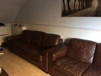 2 X 4 Seater dark brown Sofas