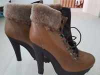 A pair of TopShop leather tan ankle boots with fur trim