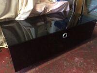 Black glass tv unit with storage