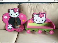 Hello Kitty mirror and a small shelf